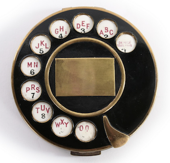 must have vintage menswear Schiaparelli telephone compact